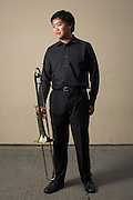 Edgar Xiong, MHS sophomore, poses for a portrait with his Trombone before performing in the Milpitas Unified School District's 11th Annual Music Festival at Milpitas High School in Milpitas, California, on April 10, 2014. (Stan Olszewski/SOSKIphoto)