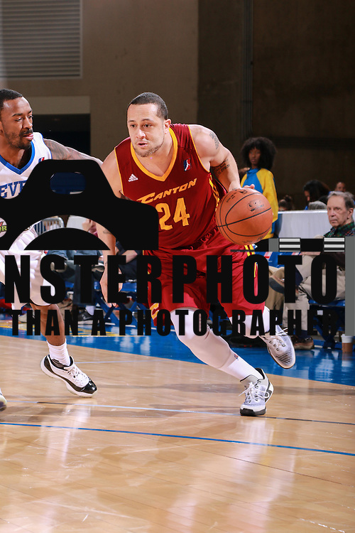 Canton Charge Guard ANTOINE AGUDIO (24) drives towards the lane as Delaware 87ers Guard RUSS SMITH (5) defends in the first half of a NBA D-league regular season basketball game between the Delaware 87ers and the Canton Charge Tuesday, JAN, 26, 2016 at The Bob Carpenter Sports Convocation Center in Newark, DEL.