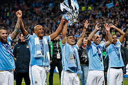 Vincent Kompany and Sergio Aguero of Manchester City lift the Capital One Cup afte their side wins on penalties - Mandatory byline: Rogan Thomson/JMP - 28/02/2016 - FOOTBALL - Wembley Stadium - London, England - Liverpool v Manchester City - Capital One Cup Final.