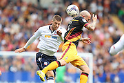Bolton Wanderers striker Jamie Proctor (9) and Bradford City midfielder Nicky Law (4) challenge for a hire ball during the EFL Sky Bet League 1 match between Bolton Wanderers and Bradford City at the Macron Stadium, Bolton, England on 24 September 2016. Photo by Simon Brady.