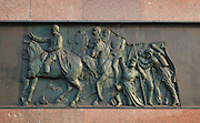 Relief scene, 1866 by Moritz Schulz, of the Prussian army in battle during the Austro-Prussian war, from the base of the Siegessaule or Berlin Victory Column, designed by Heinrich Strack and inaugurated 1873 to celebrate the victories of the Prussian army in the Danish-Prussian war, Austro-Prussian war and Franco-Prussian war, at the Grosser Stern, Grosser Tiergarten Park, Berlin, Germany. The monument takes the form of a column topped by a giant gilded bronze statue of Victoria by Friedrich Drake and a hall of red granite pillars below with a glass mosaic designed by Anton von Werner and reliefs around the base. Picture by Manuel Cohen
