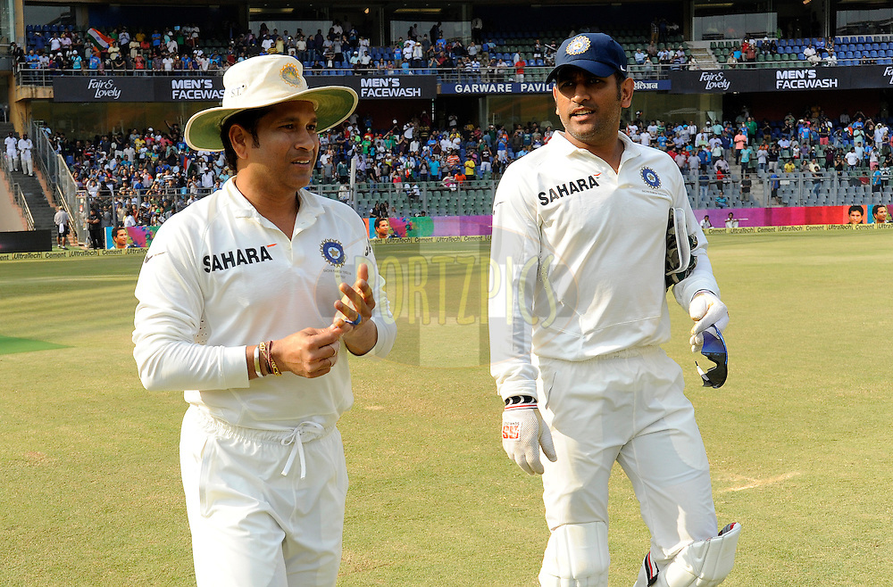 Sachin Tendulkar of India and Mahendra Singh Dhoni captain of India walk to field during day three of the second Star Sports test match between India and The West Indies held at The Wankhede Stadium in Mumbai, India on the 16th November 2013<br /> <br /> This test match is the 200th test match for Sachin Tendulkar and his last for India.  After a career spanning more than 24yrs Sachin is retiring from cricket and this test match is his last appearance on the field of play.<br /> <br /> <br /> Photo by: Pal Pillai - BCCI - SPORTZPICS<br /> <br /> Use of this image is subject to the terms and conditions as outlined by the BCCI. These terms can be found by following this link:<br /> <br /> http://sportzpics.photoshelter.com/gallery/BCCI-Image-Terms/G0000ahUVIIEBQ84/C0000whs75.ajndY