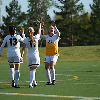 1st year defender Lauren Petras (21) of the Regina Cougars celebrates after the Women's Soccer Home Game on October 15 at U of R Field. Credit: Arthur Ward/Arthur Images