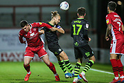Forest Green Rovers Joseph Mills(23) heads the ball under pressure from Morecambe forward Cole Stockton (9) during the EFL Sky Bet League 2 match between Morecambe and Forest Green Rovers at the Globe Arena, Morecambe, England on 22 October 2019.