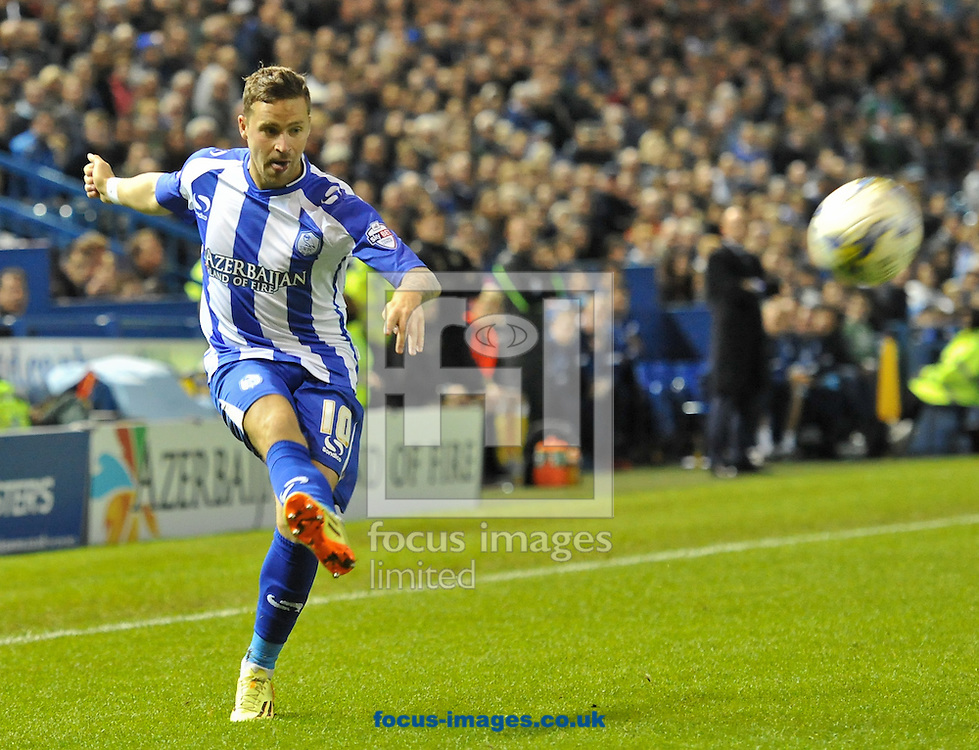 Chris Maguire of Sheffield Wednesday swings in a cross during the Sky Bet Championship match at Hillsborough, Sheffield<br /> Picture by Richard Land/Focus Images Ltd +44 7713 507003<br /> 19/08/2014
