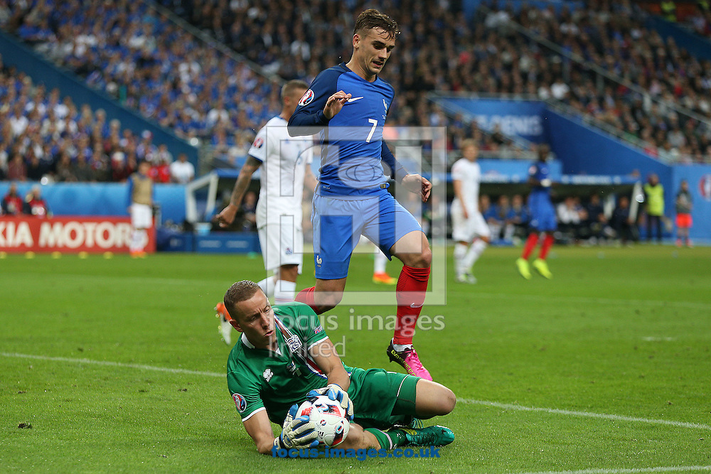 Hannes Halldorsson of Iceland saves at the feet of Antoine Griezmann of France during the quarter final match at Stade de France, Paris<br /> Picture by Paul Chesterton/Focus Images Ltd +44 7904 640267<br /> 03/07/2016