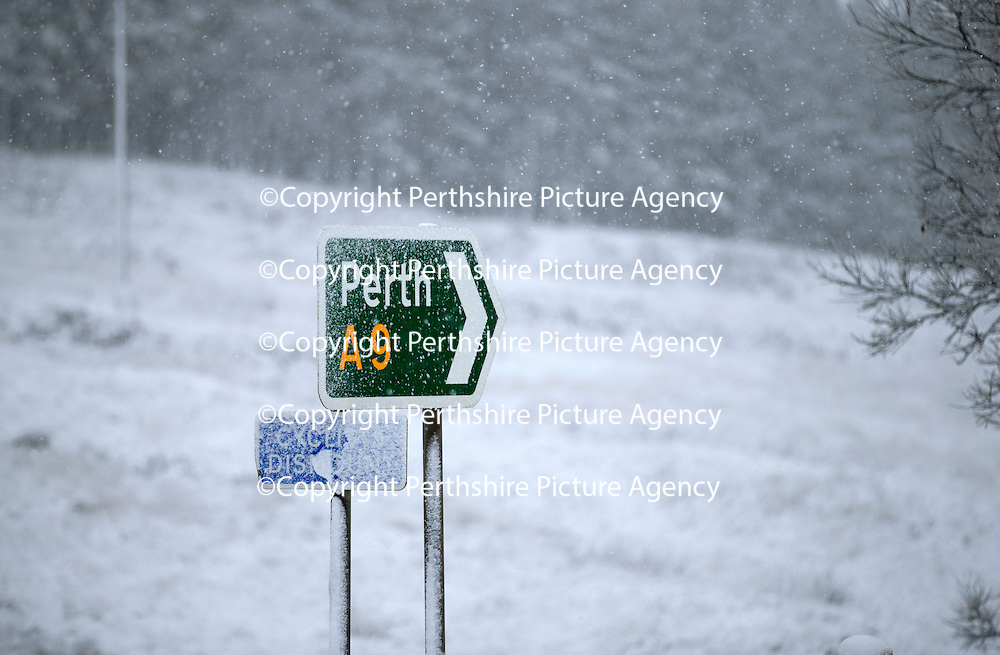 A snow covered sign the A9 north of Bruar and Calvine today near Trinafour as the first serious snowfall of the winter hits Perthshire...07.12.14<br /> Picture by Graeme Hart.<br /> Copyright Perthshire Picture Agency<br /> Tel: 01738 623350  Mobile: 07990 594431