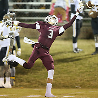 Adam Robison | BUY AT PHOTOS.DJOURNAL.COM<br /> Kossuth's Beau Lee reaches out for a pass Friday night against East Side.