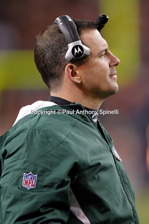 New York Jets defensive quality control coach Brian Smith looks on during the NFL week 11 football game against the Denver Broncos on Thursday, November 17, 2011 in Denver, Colorado. The Broncos won the game 17-13. ©Paul Anthony Spinelli