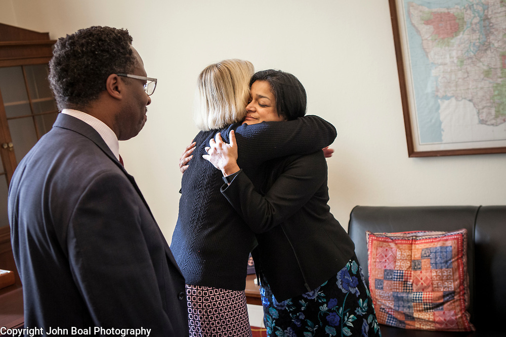 Representative Pramila Jayapal (D-WA, 7), right, finishes her first constituent meeting of the day, speaking to Mary Fertakis and Stephen Blanford, a Seattle School Board Director, of the Washington State School Directors Association, on Tuesday, January 31, 2017.  Among other topics of concern, they discussed the potential ramifications of President Trump's immigration and border security policies.  John Boal photo/for The Stranger