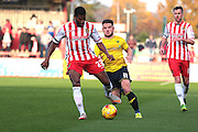 Stevenage FC defender Jerome Okimo and Oxford United midfielder Alex MacDonald during the Sky Bet League 2 match between Stevenage and Oxford United at the Lamex Stadium, Stevenage, England on 31 October 2015. Photo by Jemma Phillips.