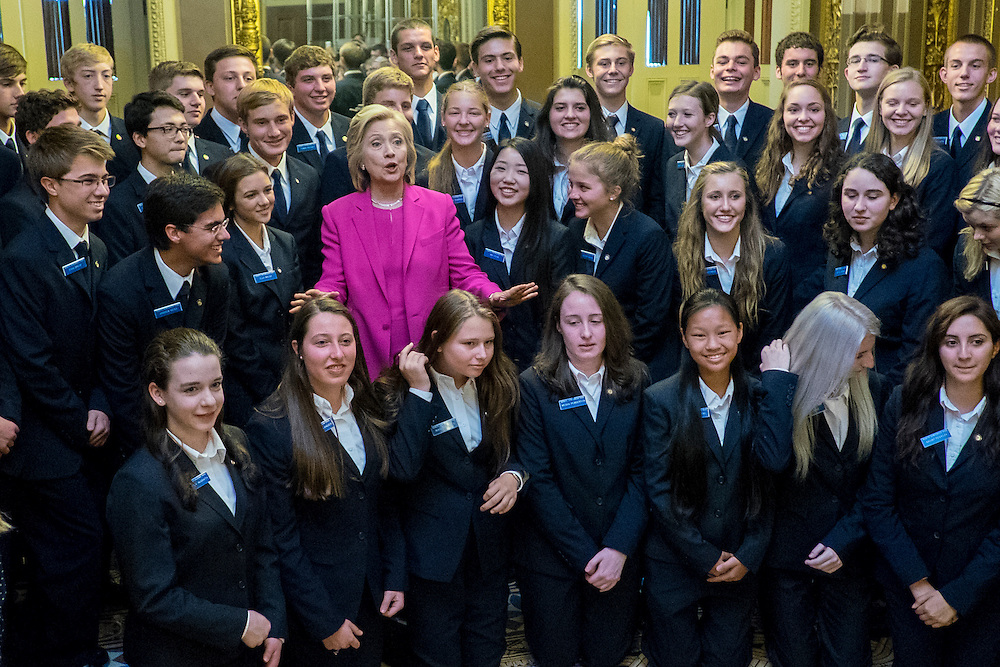US Democratic Presidential Candidate Hillary Clinton poses for a photo with Senate pages following a policy luncheon with Senate Democrats in the US Capitol in Washington, DC, on Tuesday, July 14, 2015. Clinton spent the day on Capitol Hill meeting with House and Senate democrats