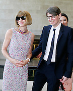 """Anna Wintour and Andrew Bolton pose Inside the """"China: Through the Looking Glass"""" exhibit at the The Costume Institute in The Metropolitan Museum of Art New York on May 04, 2015."""
