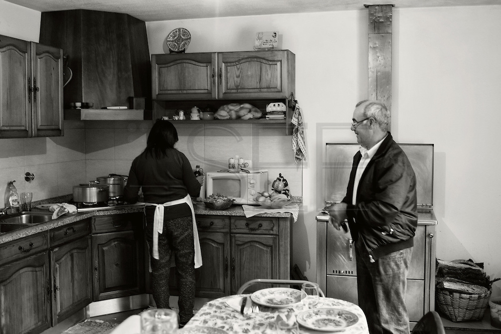 Manuela cooking in her new house for her partner