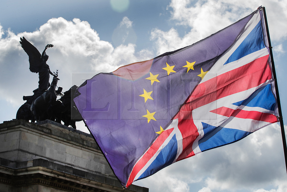 © Licensed to London News Pictures. 09/09/2017. London, UK. A conjoined EU and Union flag is held aloft at Wellington Arch on the pro EU People's March For Europe in central London. Speakers including Sir Bob Geldof, Sir Ed Davey and Liberal Democrat leader Vince Cable will address a rally in Parliament Square. Photo credit: Peter Macdiarmid/LNP