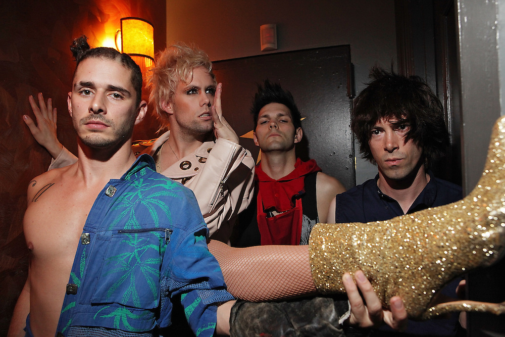 NEW YORK - APRIL 26:  (L to R) Cole Whittle, Justin Tranter, Dan Crean and Stevy Pyne of Semi Precious Weapons pose for portrait backstage at The Bowery Ballroom on April 26, 2010 in New York City.  (Photo by Roger Kisby/Getty Images)