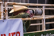PRCA photographer Joe Davis takes pictures during the Xtreme Bulls event at Bismarck Rodeo on Thursday, Feb. 1, 2018