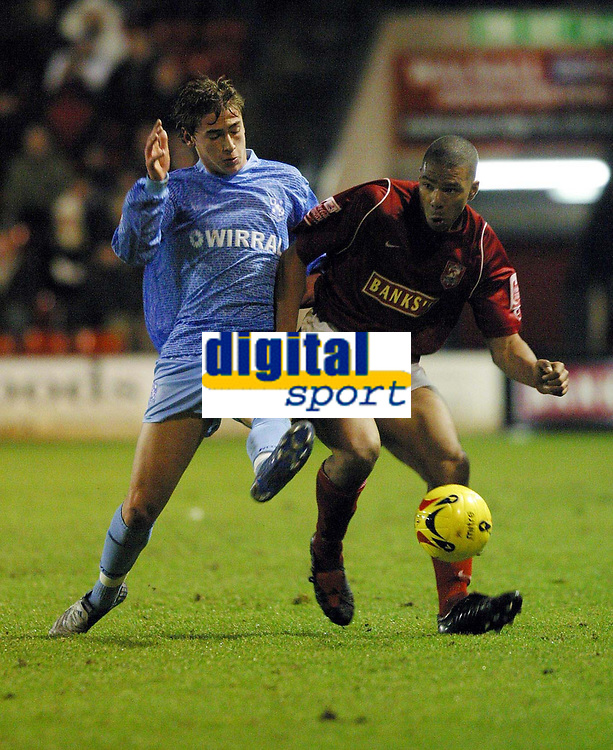 Photo: Dave Linney.<br />Walsall v Tranmere Rovers. Coca Cola League 1.<br />26/12/2005.Steve Davies(Tranmere) gets a foot to the ball in front of  Julian Bennett(Walsall)