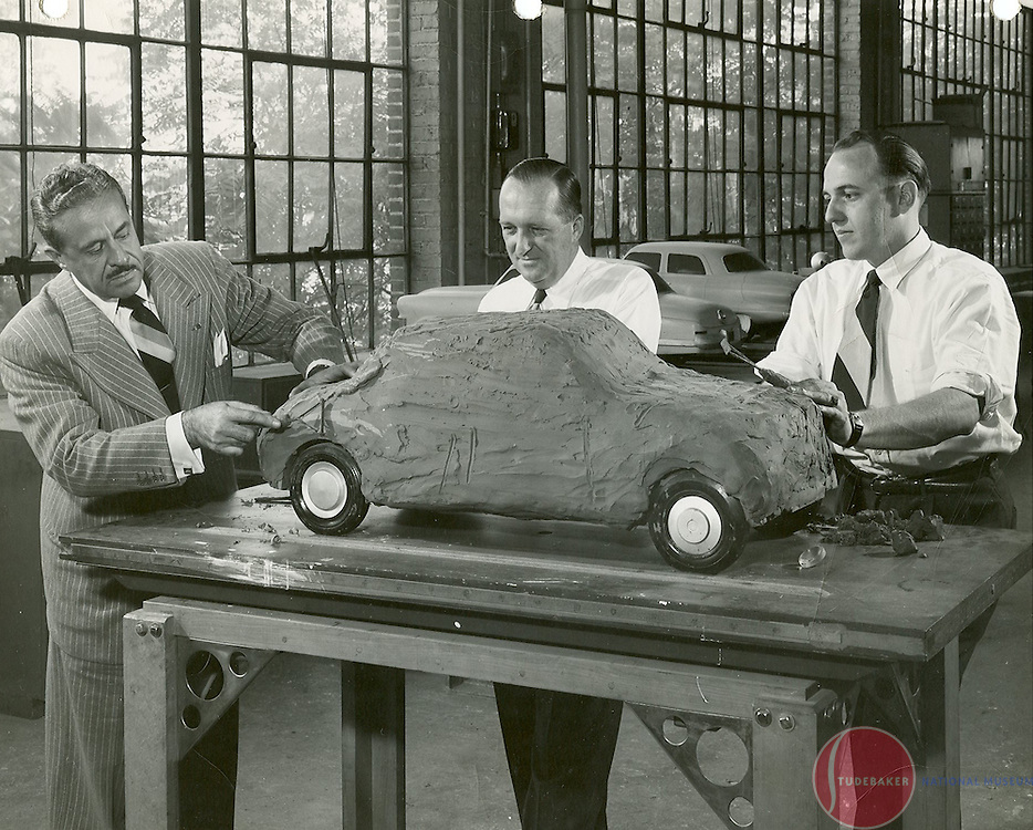 Raymond Loewy (L) shapes a clay model with George Matthews and Robert Bourke (R) c. 1945
