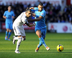 Tottenham Hotspur's Nacer Chadli battles for the ball with Swansea City's Chico - Photo mandatory by-line: Joe Meredith/JMP - Tel: Mobile: 07966 386802 19/01/2014 - SPORT - FOOTBALL - Liberty Stadium - Swansea - Swansea City v Tottenham Hotspur - Barclays Premier League