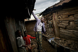 Children play in Mathare, one of the poorest slums in Nairobi.  Running water and electricity are scarce and trash and human waste fills the streets.  Many people have no jobs and those who do work can earn less than one dollar a day.