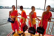 Monks on taxi boat, Bangkok, Thailand