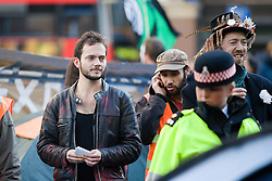 © Licensed to London News Pictures. 25/10/2011. London, UK. Anarchist student Jack Hartcup (left), an activist at the centre of St Paul's protest who has been revealed as the son of a property tycoon. Hartcup, who is studying a philosophy degree, has played a major part in the demonstrations against capitalism outside St Paul's Cathedral and at the Dale Farm illegal travellers' site. until three years ago, the 21-year-old student was living in one of his father's £1.5millon apartments in North London. Photo credit: Ben Cawthra/LNP