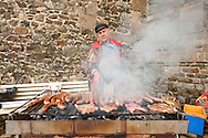 Granville Carnival, Normandy, France. Man selling sausages during the main procession, on the last Sunday before Lent. The carnival in Granville is the largest in Normandy, drawing some 120,000 people to this small town on the coast with a population of just 10,000, and has been running for 141 years (15 February 2015). © Rudolf Abraham