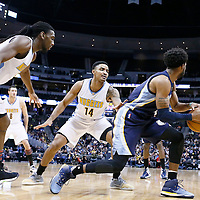 01 February 2016: Denver Nuggets guard Gary Harris (14) and Denver Nuggets forward Kenneth Faried (35) defend on Memphis Grizzlies guard Mike Conley (11) during the Memphis Grizzlies 119-99 victory over the Denver Nuggets, at the Pepsi Center, Denver, Colorado, USA.