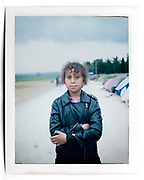 Idomeni Camp, Idomeni, Greece, April 2016.<br /> <br /> I asked the subjects to pose but I did not direct the scene. The subjects decided where and how to pose. <br /> <br /> The original picture is a Polaroid Fujifilm FP-100C, which I re-photographed with Nikon 800 in my studio. Polaroid Camera: Polaroid 30 and Polaroid 103. The original picture can be provided upon request.