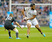 Twickenham, United Kingdom, England's, Billy VUNIPOLA looks to off load the ball during during the 2013 QBE  AutumnRugby International, England vs New Zealand, played  Saturday  16/11/2013 at the RFU Stadium Twickenham,<br /> England. [Mandatory Credit: Peter Spurrier/Intersport<br /> Images}