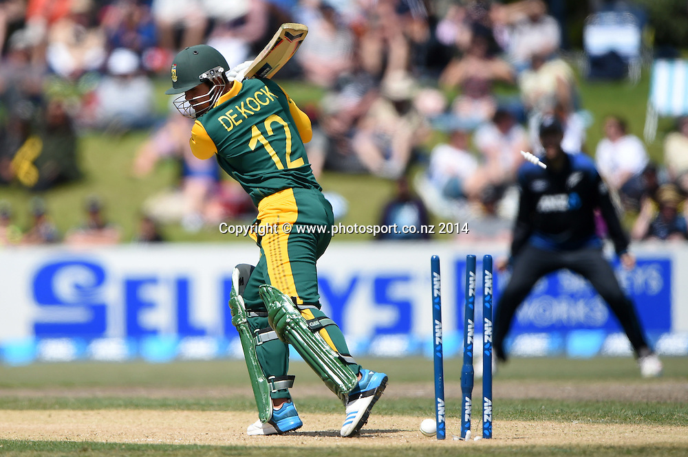 Quinton de Kock is bowled by Mitchell McClenaghan. ANZ One Day International Cricket Series between New Zealand Back Caps and South Africa, Bay Oval, Mount Maunganui, New Zealand. Friday 24 October 2014. Photo: Andrew Cornaga/www.Photosport.co.nz