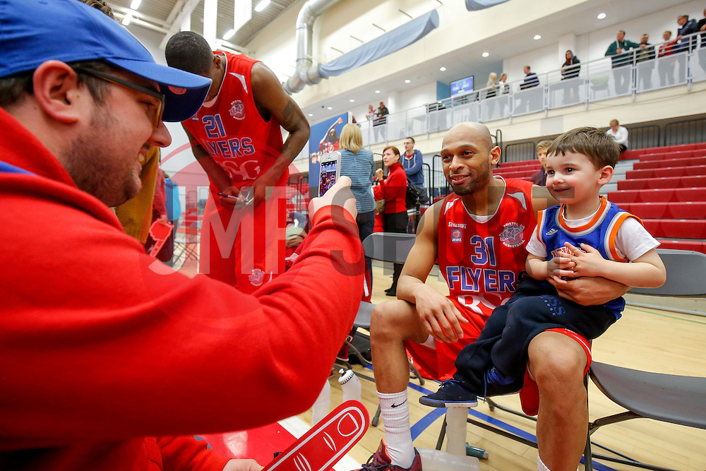 Cardell McFarland of Bristol Flyers takes a photo with a young fan - Mandatory byline: Rogan Thomson/JMP - 18/03/2016 - BASKETBALL - SGS Wise Arena - Bristol, England - Bristol Flyers v Cheshire Pheonix - BBL Championship.