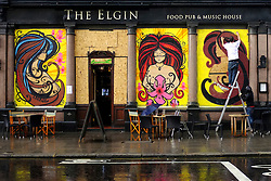 © Licensed to London News Pictures. 25/08/2012. London, UK The Elgin pub on Ladbrook Grove is boarded up and decorated. Shops and premises are boarded up today 25th August 2012 ahead of the Notting Hill Carnival which takes place this weekend.  Photo credit : Stephen Simpson/LNP