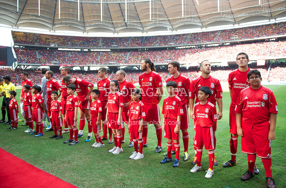KUALA LUMPUR, MALAYSIA - Saturday, July 16, 2011: Liverpool players line-up before playing a Malaysia XI at the National Stadium Bukit Jalil in Kuala Lumpur on day six of the club's Asia Tour. (Photo by David Rawcliffe/Propaganda)