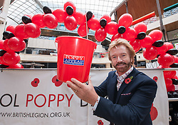 © Licensed to London News Pictures. 29/10/2015. Bristol, UK. Bristol Poppy Day. NOEL EDMONDS joins poppy sellers and meets the public to raise the profile of the Royal British Legion's Poppy Appeal campaign in Bristol at Cabot Circus shopping centre, in the two week countdown to Remembrance Day. Photo credit : Simon Chapman/LNP