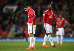 Manchester United's Alexis Sanchez stands dejected after the final whistle