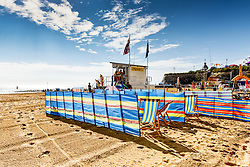 Colourful windbreaks on the beach at Viking Bay in Broadstairs, Kent.