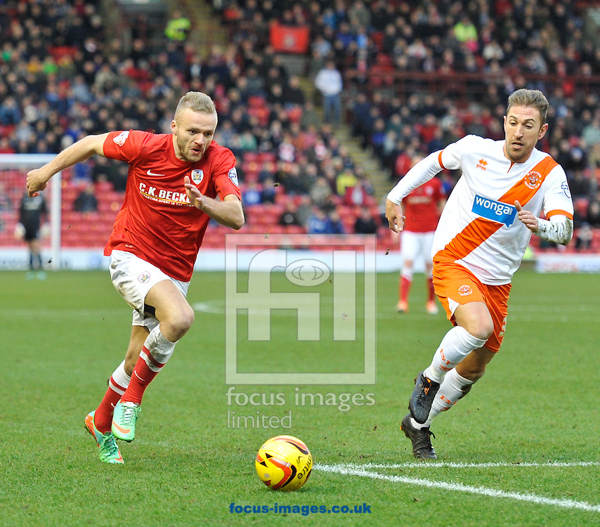 Picture by Richard Land/Focus Images Ltd +44 7713 507003<br /> 18/01/2014<br /> <br /> Ryan McLaughlin of Barnsley and Angel Martinez of Blackpool during the Sky Bet Championship match at Oakwell, Barnsley.