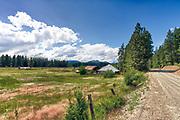 USA, Washington, near Roslyn. Rural farmhouse and field.