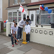 Kids play street cricket in Southall area of West London