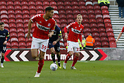 Middlesbrough midfielder George Saville (22) finds Middlesbrough forward Rudy Gestede (39)  during the EFL Sky Bet Championship match between Middlesbrough and Derby County at the Riverside Stadium, Middlesbrough, England on 27 October 2018.