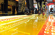 TAIYUAN, CHINA - NOVEMBER 19: (CHINA OUT) <br /> <br /> Twelve-meter-long Golden Road <br /> <br /> People take pictures on a road covered by gold coins on November 19, 2014 in Taiyuan, Shanxi province of China. A jewelry shop paved a road with gold coins during its upcoming shop celebration at the shopping mall to attract consumers. <br /> ©Exclusivepix