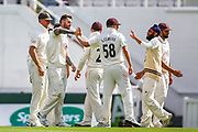 Jordan Clark of Surrey celebrates his first wicket Felix Organ of Hampshire bowled and caught by Ben Foakes of Surrey during the Specsavers County Champ Div 1 match between Surrey County Cricket Club and Hampshire County Cricket Club at the Kia Oval, Kennington, United Kingdom on 18 August 2019.