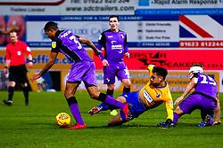 Tyler Walker of Mansfield Town trips Cristian Montano of Port Vale - Mandatory by-line: Ryan Crockett/JMP - 17/11/2018 - FOOTBALL - One Call Stadium - Mansfield, England - Mansfield Town v Port Vale - Sky Bet League Two