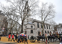 © Licensed to London News Pictures. 17/04/2013. London, United Kingdom. The funeral of Baroness Margaret Thatcher former British Prime Minister at St Paul Cathedral.   Baroness Margaret Thatchers body is taken out of St Clement Danes on its way to St Pauls in London on the 17th April 2013. Photo credit : Justin Setterfield/LNP..