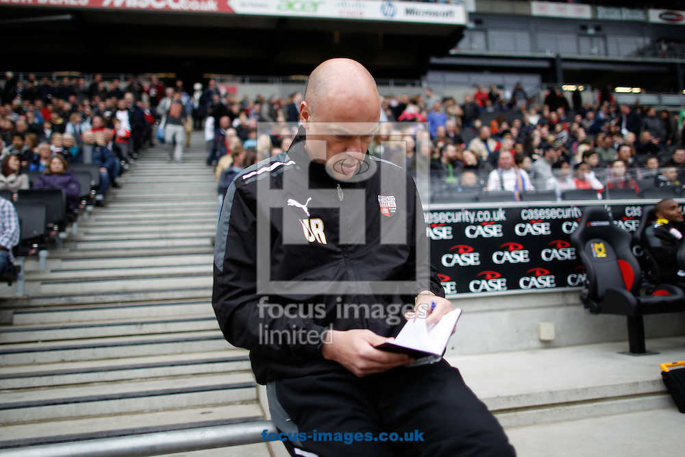 Picture by Andrew Tobin/Focus Images Ltd. 07710 761829.31/03/12 - Uwe Rosler - manager of Brentford consults his tactics book during the Npower League 1 match at Stadium mk, Milton Keynes.