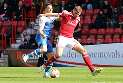 Peterborough United's Connor Washington battles with Swindon Town's Jack Stephens - Photo mandatory by-line: Joe Dent/JMP - Mobile: 07966 386802 - 11/04/2015 - SPORT - Football - Swindon - County Ground - Swindon Town v Peterborough United - Sky Bet League One