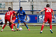 AFC Wimbledon attacker Michael Folivi (17) taking on Accrington Stanley midfielder Sean McConville (11) during the EFL Sky Bet League 1 match between AFC Wimbledon and Accrington Stanley at the Cherry Red Records Stadium, Kingston, England on 17 August 2019.