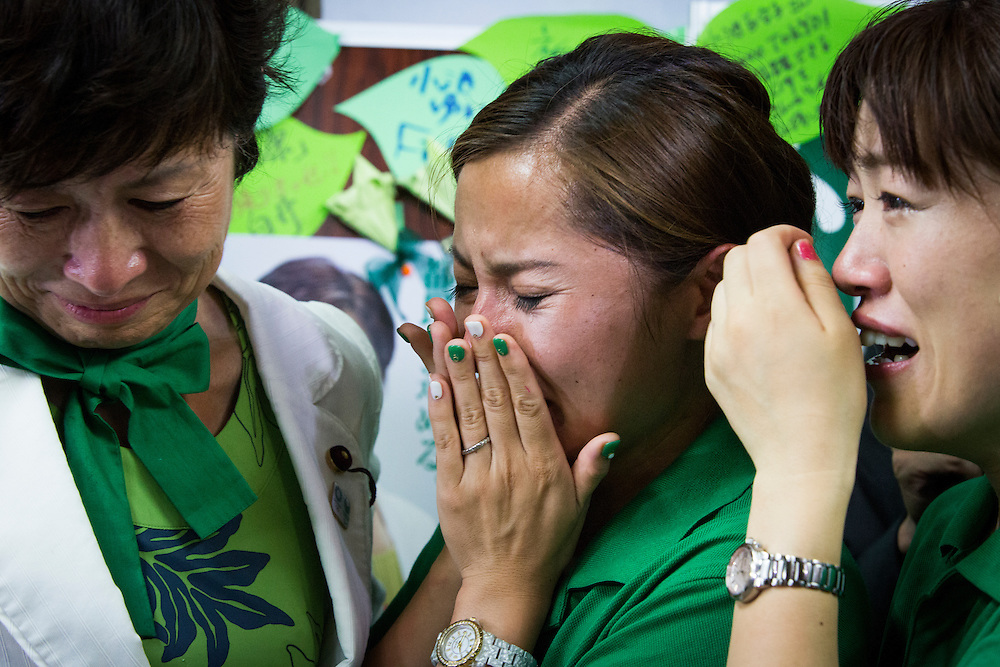 TOKYO, JAPAN - JULY 31 : Supporters of Yuriko Koike, cries as they celebrate victory after winning the Tokyo gubernatorial election at her office during the press conference in Tokyo, Japan, on Sunday, July 31, 2016. Yuriko Koike a Liberal Democratic Party lawmaker and former defense minister is the first women to be elected as a Governor of Tokyo. (Photo: Richard Atrero de Guzman/NURPhoto)